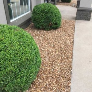 Flowerbed Rock Installation and Bush Trimming